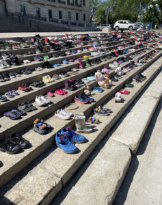 Children's shoes lined the steps of the legislature earlier this week.